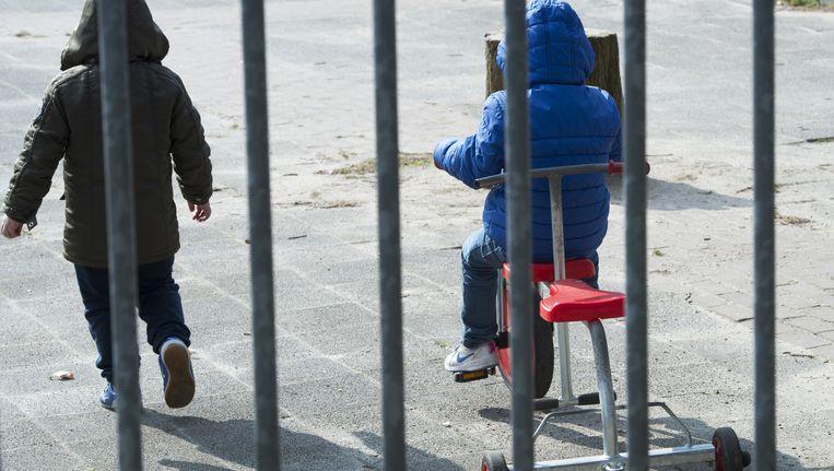 Kinderen op een speelplein in Maastricht. Beeld anp