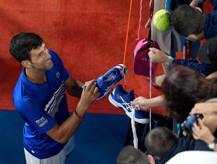 Novak Djokovic stelt zijn supporters niet teleur. Beeld AP