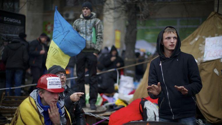 Demonstranten op het Onafhankelijkheidsplein in Kiev. Beeld ap