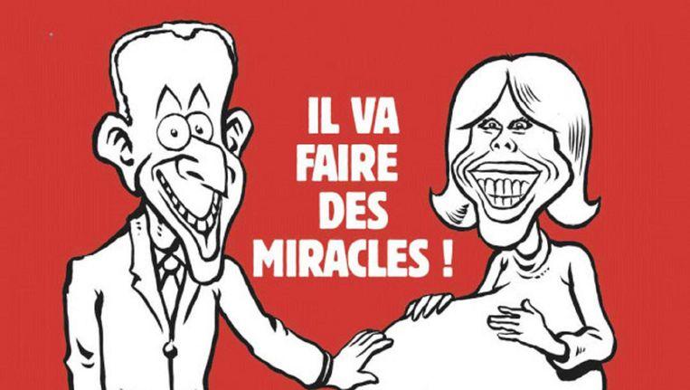 De omstreden cover van Charlie Hebdo. 'Hij gaat wonderen verrichten'. Beeld Twitter