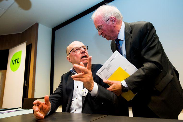 VRT-voorzitter Luc Van den Brande (rechts) haalde in januari Leo Hellemans (geboren in 1951) terug aan boord als interim-gedelegeerd bestuurder. De gewezen radiojournalist bekleedde deze functie  al van 2014 tot aan zijn pensioen in 2016.