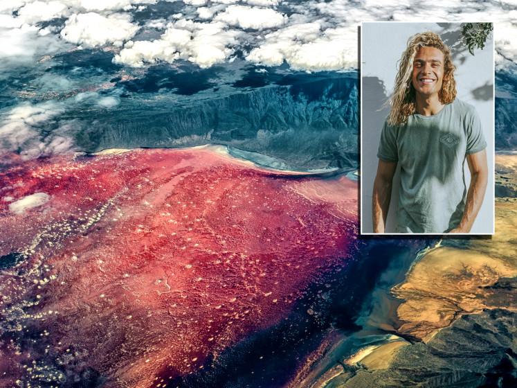 Alles voor de superfoto: Roderick gaat kitesurfen op gifmeer