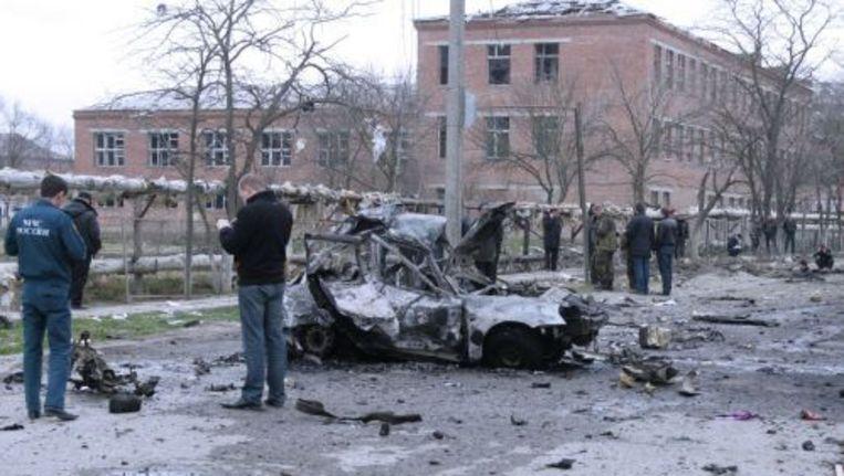 Politie onderzoekt in Kizlyar de plek waar de bommen afgingen. ANP Beeld