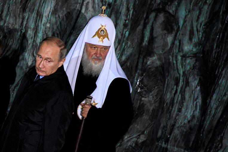 Russische president Vladimir Poetin en patriarch Kirill, hoofd van de Russische Orthodoxe Kerk Beeld REUTERS