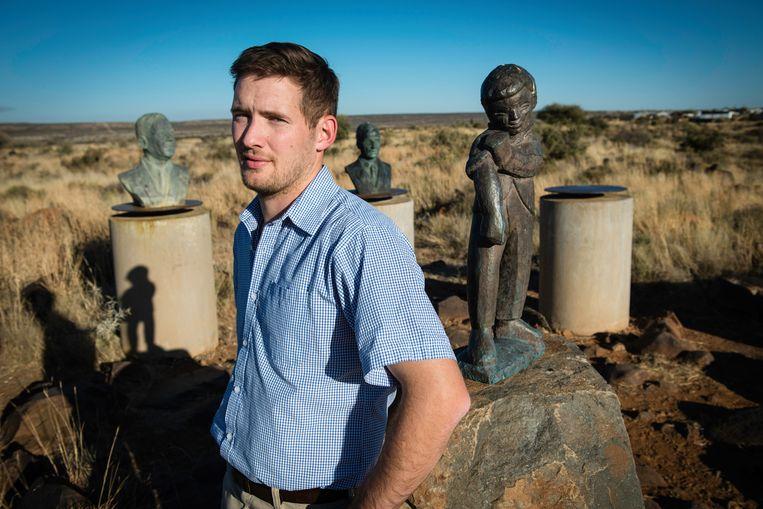 Joost Strydom, hoofd communicatie van Orania, in de beeldentuin van vroegere Afrikaner leiders.  Beeld Bram Lammers