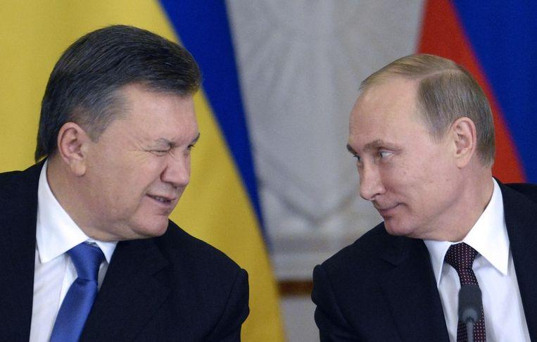 Janoekovitsj (links) met zijn vriend Vladimir Poetin. Beeld afp