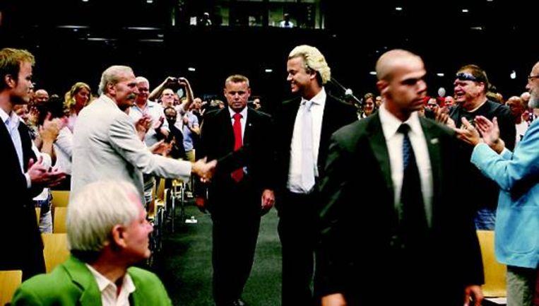 Wilders en zijn aanhangers op een PVV-congres. (Jorgen Caris) Beeld