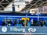 Kermisbouwers lopen dicht langs het spoor: treinen rond Tilburg rijden langzamer