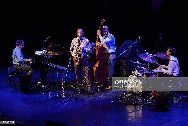 Joey Calderazzo, Branford Marsalis, Eric Revis en Evan Sherman van het Branford Marsalis Quartet op het London Jazz Festival in 2014. Beeld Getty Images