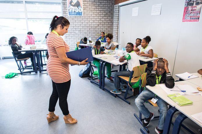 De schoolsluiting kwam het hardst aan bij scholen waar al een risico op achterstand was.