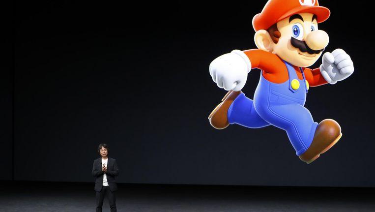 Videogameontwerper Shigeru Miyamoto bij de presentatie van Super Mario Run voor de iPhone. Beeld afp