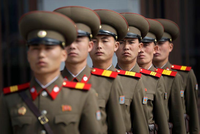 En meer soldaten wachten tot hun deelname begint. Beeld AP