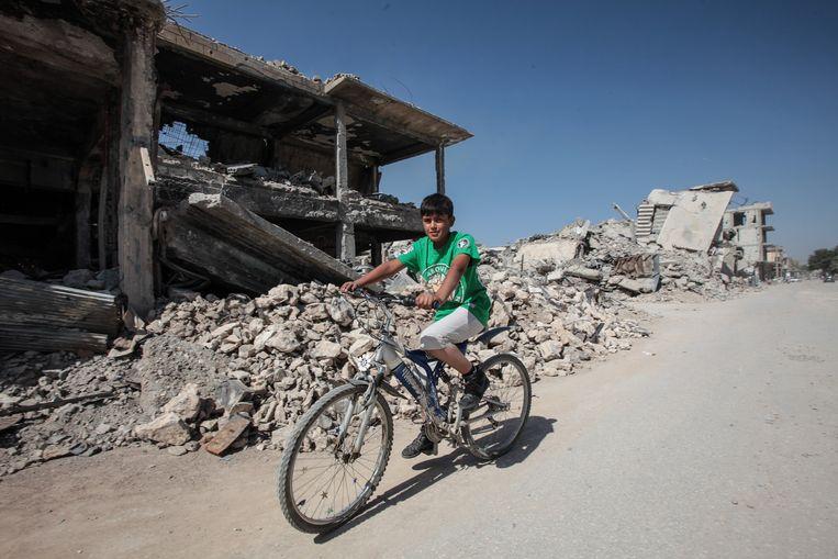 Kobani, vorige week. Grote delen van de stad zijn verwoest door de oorlog tegen IS. Beeld getty