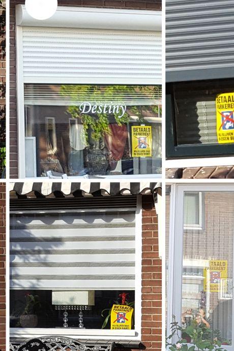 'Honderden posters' voor de ramen als protest tegen betaald parkeren