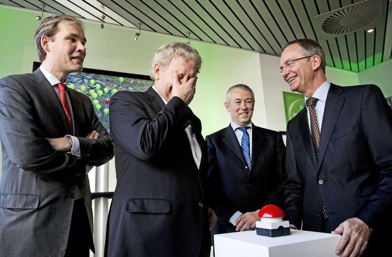 Joost Farwerck van KPN (links, toen nog managing director) met toenmalig burgemeester Eberhard van der Laan van Amsterdam, KPN-topman Eelco Blok en minister Henk Kamp van Economische Zaken tijdens de lancering van het 4G netwerk in de Randstad.  Beeld ANP