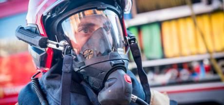 Buren redden vrouw uit brandende woning