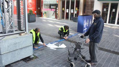 Winkelstraten worden klaargestoomd voor heropening winkels met pijlen, digitale borden en wasstraten