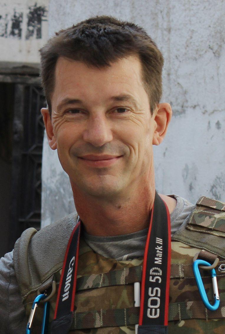 John Cantlie, gefotografeerd in de Syrische stad Aleppo in 2012, kort voordat hij ontvoerd zou worden. Beeld AP