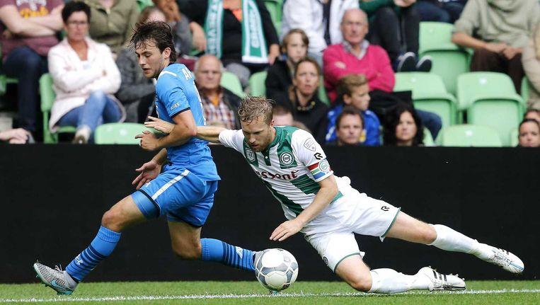 Joris van Overeem (L) in duel met Rasmus Lindgren Beeld anp