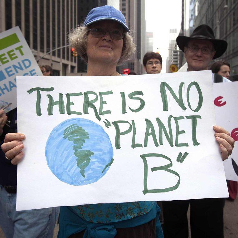 Tienduizenden mensen gingen zondag in New York de straat op om te demonstreren over klimaatverandering. Beeld reuters
