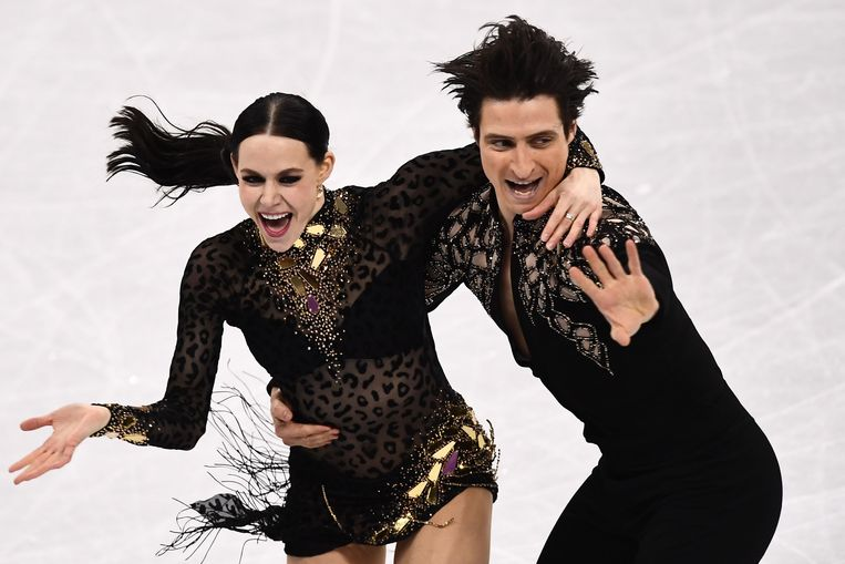 Tessa Virtue (l) en Scott Moir