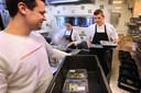 Ook Michelinrestaurant Wolfslaar in Breda bezorgt maaltijden. Restaurant-manager Daan Smits (L) en sous-chef Willem Hamers (r) maken de gerechten gereed voor transport.