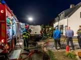 Keukenbrand in woning in 's Gravenmoer, veel rook in de straat