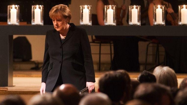 De Duitse bondskanselier Angela Merkel vandaag tijdens een herdenkingsbijeenkomt van de slachtoffers van de 'dönermoorden'. © ANP Beeld