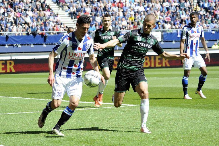 Heerenveen-speler Stefano Marzo met Jesper Drost (FC Groningen). Beeld anp