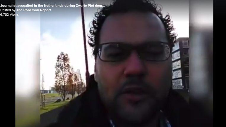 Stil uit het filmpje waarin te zien is hoe Kevin P. Roberson op het hoofd wordt geslagen. Beeld The Roberson Report (Facebook)