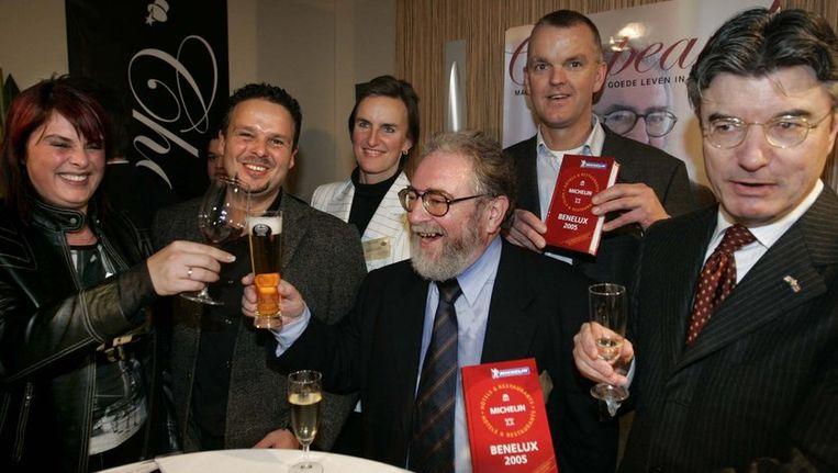 Van Craenenbroek (midden, met baard) bij de presentatie van de Michelingids voor de Benelux in 2005. Beeld
