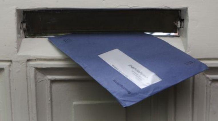 De blauwe belasting envelop. ANP Beeld