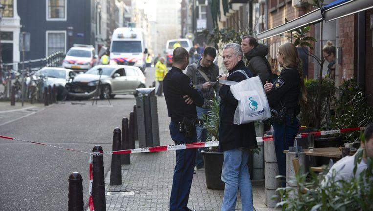 Bram Moszkowicz zat op 8 maart 2014 samen met zijn dochter in de auto, toen hij in de Nieuwe Spiegelstraat werd aangereden. Beeld ANP