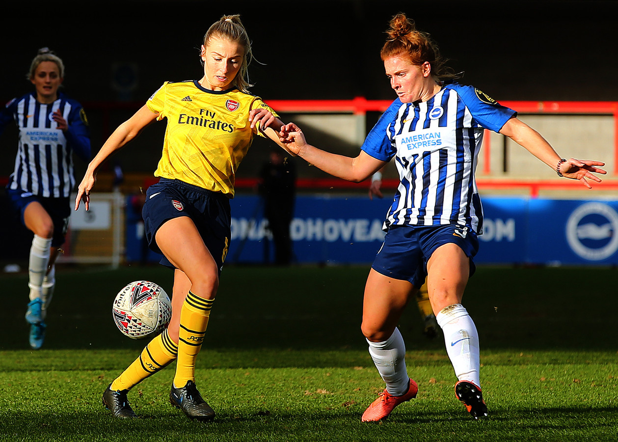 Arsenal's Leah Williamson and Brighton's Felicity Gibbons challenge for a loose ball during the Women's Super League match at The People's Pension Stadium, Crawley.