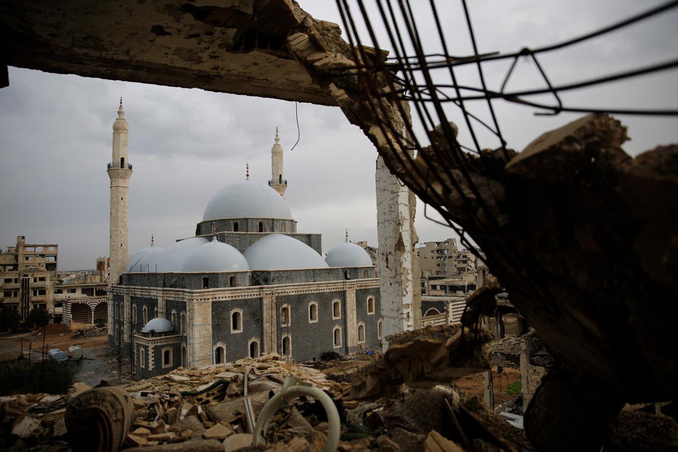 De aangehouden Syriër zou een van de daders zijn die twintig leden van een familie in Homs ombrachten.