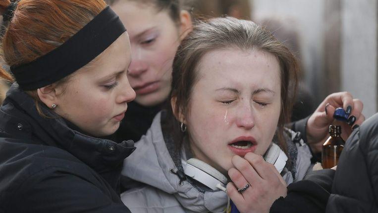 Nabestaanden van overleden militairen rouwen om hun familieleden