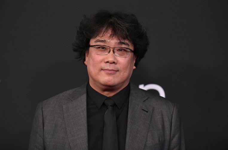 Regisseur Bong Joon-ho: 'Ik wil niet overkomen als een sadist, maar ik vind het prachtig als mensen lachen terwijl ze niet zeker weten of ze wel mogen lachen.' Beeld Richard Shotwell/Invision/AP