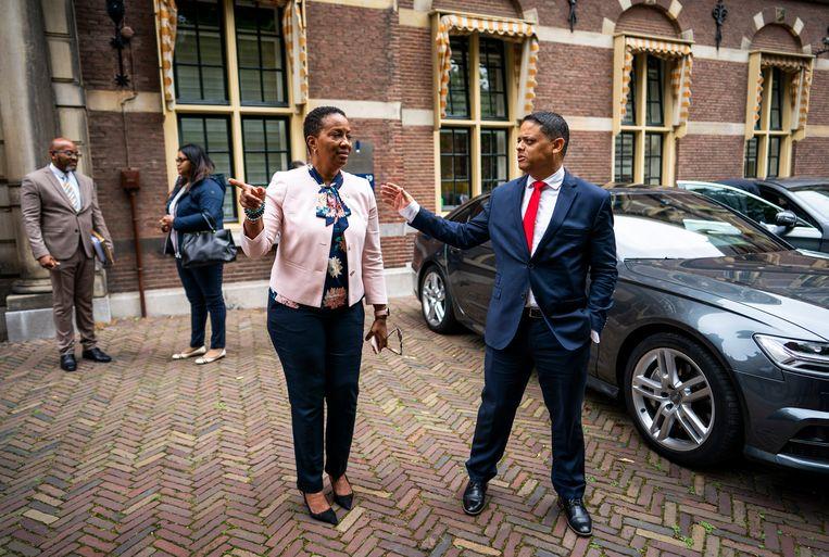 Silveria Jacobs, premier van Sint Maarten, en Eugene Rhuggenaath, premier van Curaçao, vrijdag na afloop van de rijksministerraad in Den Haag. Beeld Freek van den Bergh / de Volkskrant