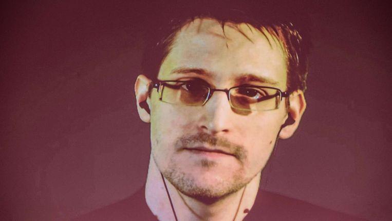 Edward Snowden via een videoverbinding met een conferentie in Hanover, Duitsland. Beeld afp