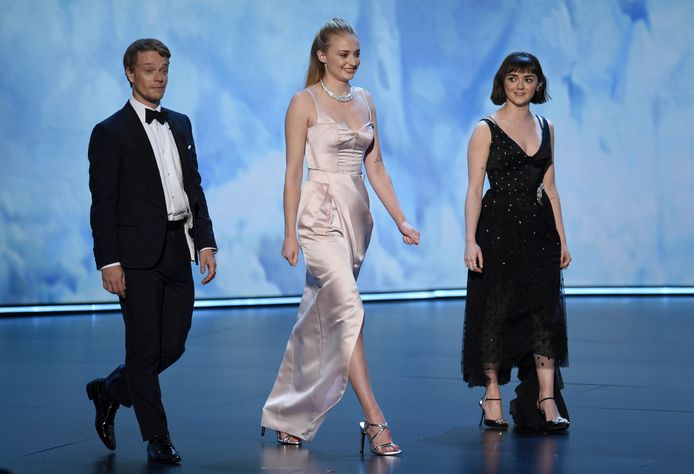 """Alfie Allen, from left, Sophie Turner, and Maisie Williams, of the cast of """"Game of Thrones,"""" appear on stage to present the award"""