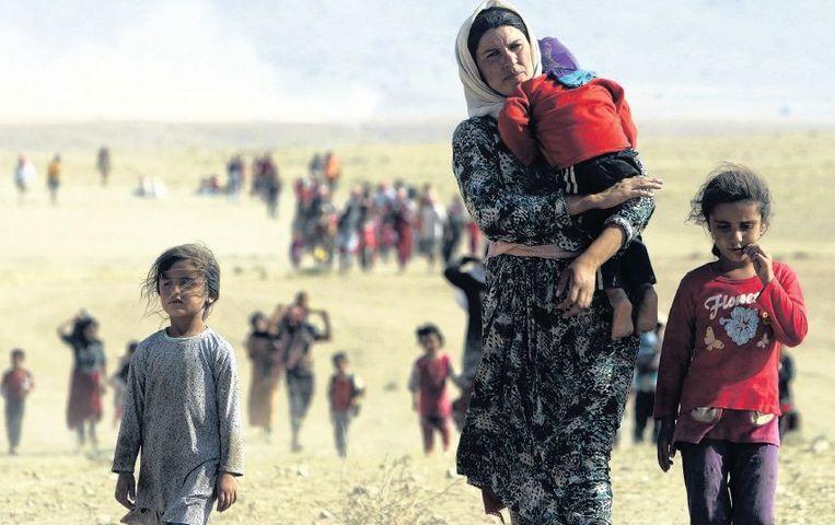 Yezidi's op de vlucht voor het geweld van IS. Beeld reuters