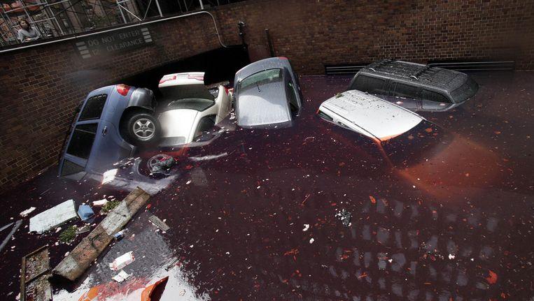 Auto's bij een parkeergarage in het financiële district van New York. Beeld ap