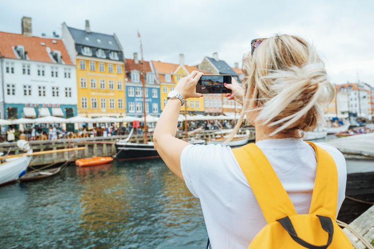 Foto ter illustratie van een toerist in Kopenhagen, Denemarken.