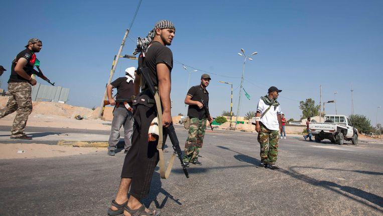 Libische rebellen in augustus 2011. Mohammed Al Shosni staat niet op de foto. Beeld AP