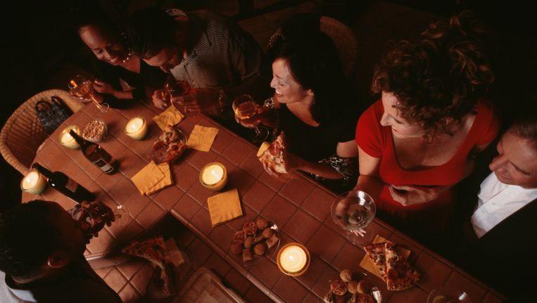 Archieffoto van gezelschap in een restaurant Beeld Thinkstock