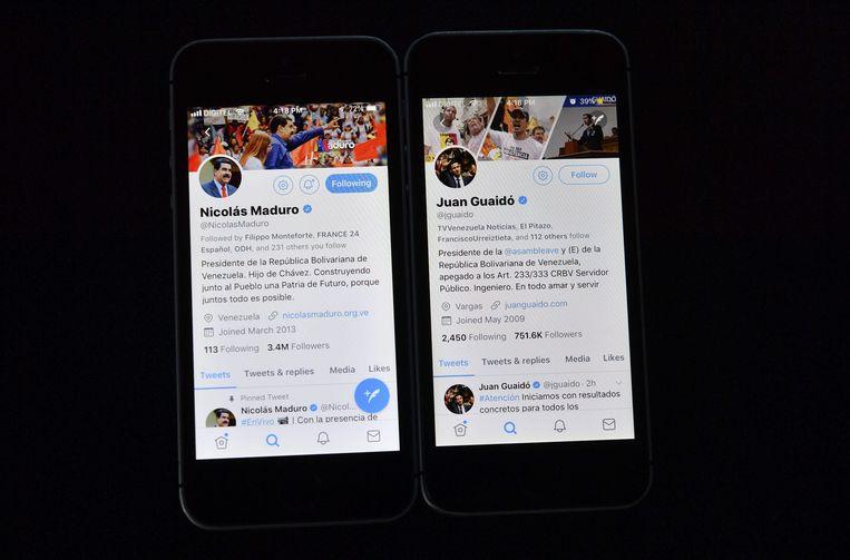 De Twitter-profielen van president Nicolas Maduro en Juan Guaidó, de man die zichzelf heeft uitgeroepen tot interim-president van Venezuela. Beeld AFP