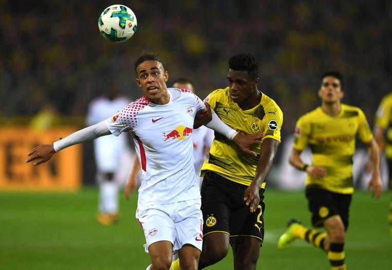 Poulsen houdt de Franse Dortmund-verdediger Zagadou af.
