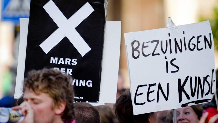 Protestborden tijdens de Mars der Beschaving. Beeld anp