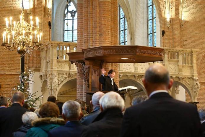 Dominee Jan Meertens op de spreekstoel in de Cunerakerk.Foto Tamara Reijers