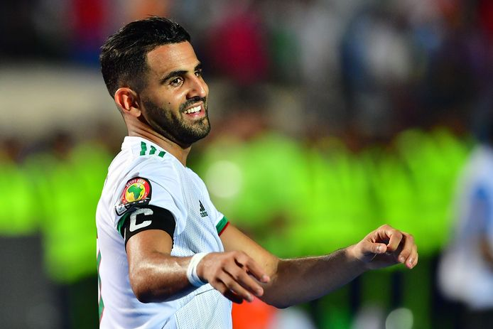 Algeria's forward Riyad Mahrez celebrates after winning the 2019 Africa Cup of Nations (CAN) Final football match between Senegal and Algeria at the Cairo International Stadium in Cairo on July 19, 2019. (Photo by Giuseppe CACACE / AFP)